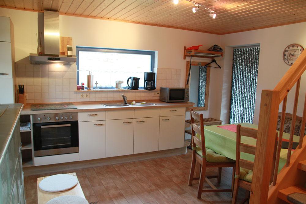Ferienhaus mit Küchenzeile und Esstisch